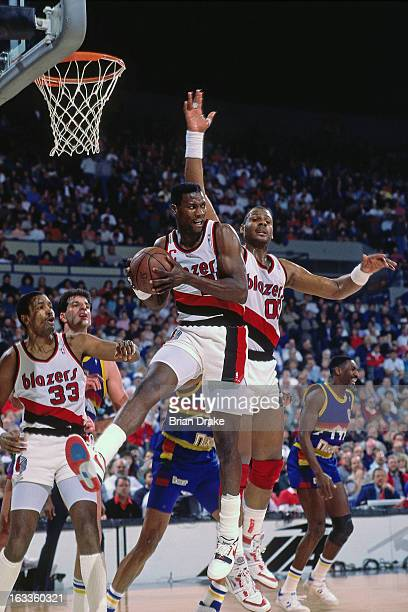 Jerome Kersey of the Portland Trail Blazers rebounds against the Denver Nuggets during a game played circa 1988 at the Veterans Memorial Coliseum in...