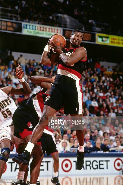 Jerome Kersey of the Portland Trail Blazers rebounds against the Denver Nuggets circa 1994 at the McNichols Sports Arena in Denver Colorado NOTE TO...