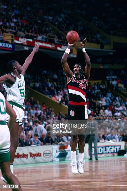 Jerome Kersey of the Portland Trail Blazers shoots a jump shot against the Boston Celtics during a game played in 1989 at the Boston Garden in Boston...