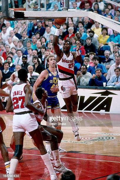 Jerome Kersey of the Portland Trail Blazers shoots against the Utah Jazz during a game played circa 1987 at the Veterans Memorial Coliseum in...
