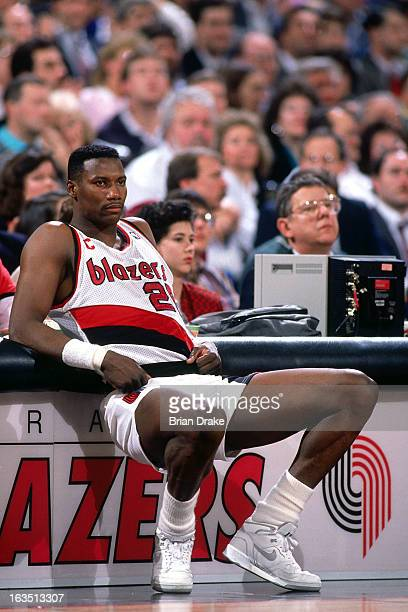 Jerome Kersey of the Portland Trail Blazers sits at the scorers table during a game played circa 1989 at the Veterans Memorial Coliseum in Portland...