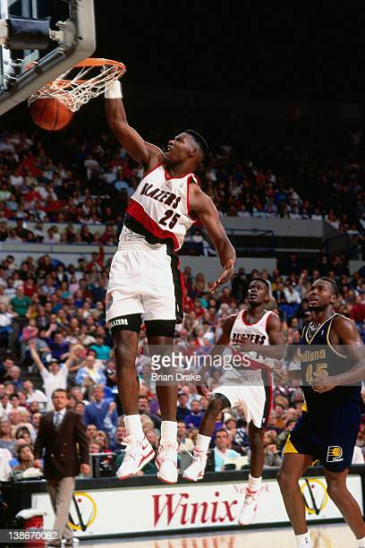 Jerome Kersey of the Portland Trailblazers dunks against the Indiana Pacers during a game played circa 1991 at the Veterans Memorial Coliseum in...