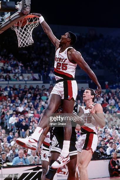 Jerome Kersey of the Portland Trailblazers dunks against the San Antonio Spurs at the Veterans Memorial Coliseum in Portland Oregon circa 1987 NOTE...