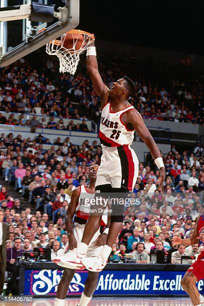 Jerome Kersey of the Portland Trailblazers dunks at the Veterans Memorial Coliseum in Portland Oregon circa 1992 NOTE TO USER User expressly...