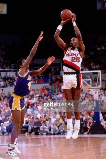 Jerome Kersey of the Portland Trailblazers shoots against AC Green of the Los Angeles Lakers during a game played circa 1989 at Memorial Coliseum in...