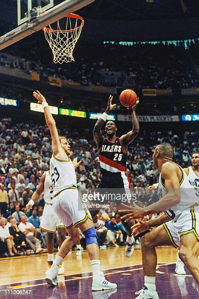 Jerome Kersey of the Portland Trailblazers shoots against Mark Eaton of the Utah Jazz at the Delta Center in 1992 in Salt Lake City Utah NOTE TO USER...
