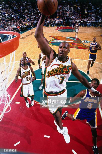 Jerome Kersey of the Seattle Supersonics dunks against the Los Angeles Lakers in Game Five of the Western Conference Semifinals as part of the 1998...