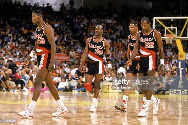 Jerome Kersey Terry Porter and Clyde Drexler of the Portland Trail Blazers walk during the 19891990 NBA season game at the Great Western Forum in Los...