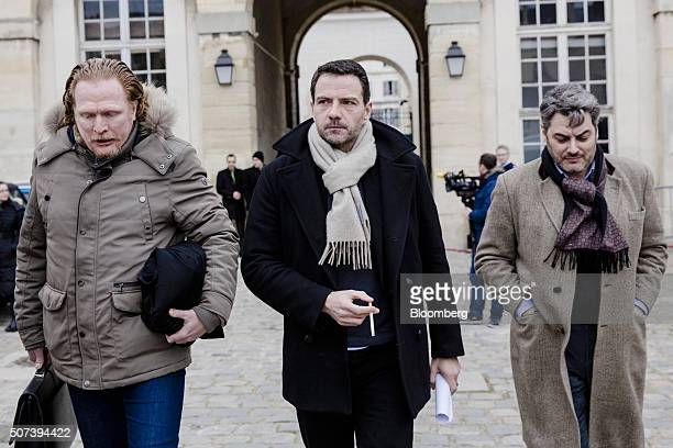 Jerome Kerviel former trader for Societe Generale SA center holds a cigarette as he leaves Versailles courthouse with Benoit Pruvost a lawyer left in...
