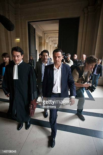 Jerome Kerviel the former trader at Societe Generale SA center and his lawyer David Koubbi left arrive outside the Paris appeal courts on the opening...