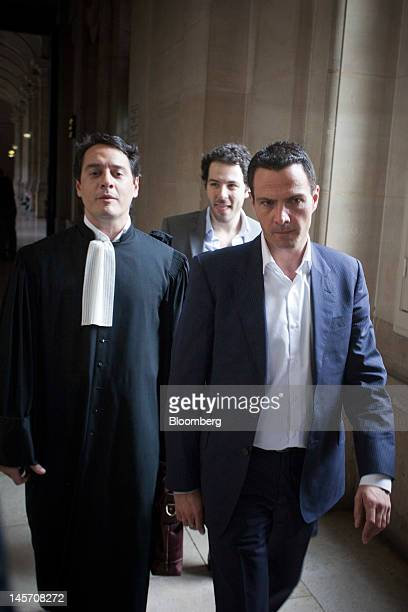 Jerome Kerviel the former trader at Societe Generale SA right and his lawyer David Koubbi arrive outside the Paris appeal courts on the opening day...