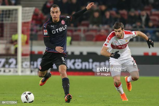 Jerome Kiesewetter of Fortuna Duesseldorf and Emiliano Adrian Insua Zapata of Stuttgart battle for the ball during the Second Bundesliga match...