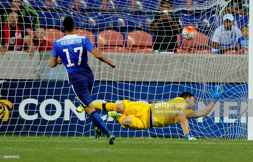 Jerome Kiesewetter #17 of the United States scores a penalty kick goal, beating goalie Maxime Crepeau #1 of Canada, on the United States way to a 2-0 win over Canada during the third place CONCACAF Olympic Qualifying match at Rio Tinto Stadium on October 13, 2015 in Sandy, Utah.