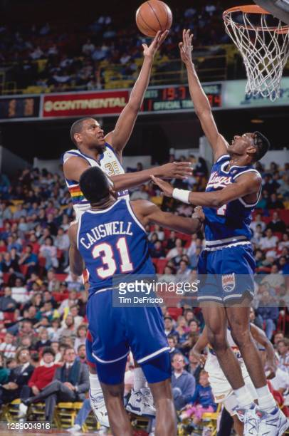 Jerome Lane, Power Forward for the Denver Nuggets rolls a layup to the hoop as Rick Calloway, Shooting Guard for the Sacramento Kings attempts to...