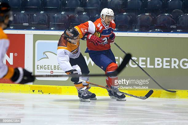 Jerome Leduc of Dynamo Pardubice in clash with Sebastian Furchner of Grizzlys Wolfsburg during the Champions Hockey League match between Dynamo...