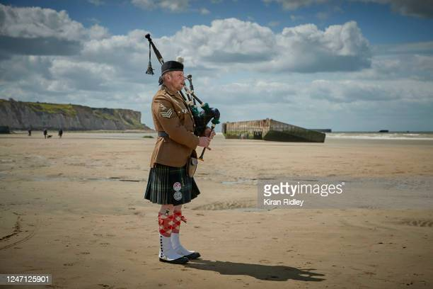 Jerome Levannier, a lone piper, plays Amazing Grace as he walks on Gold Beach in Arromanches to commemorate the 76th Anniversary of the D-Day...