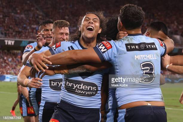 Jerome Luai of the Blues celebrates with team mates after a try scored by Brian To'o of the Blues during game one of the 2021 State of Origin series...