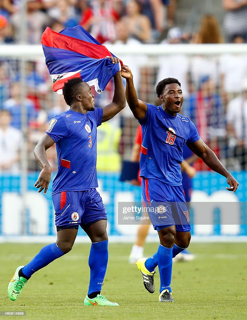 Jerome Mechack #3 and Judelin Aveska #18 of Haiti celebrate after Haiti defeated Honduras 1-0 to win their 2015 CONCACAF Gold Cup match at Sporting Park on July 13, 2015 in Kansas City, Kansas.