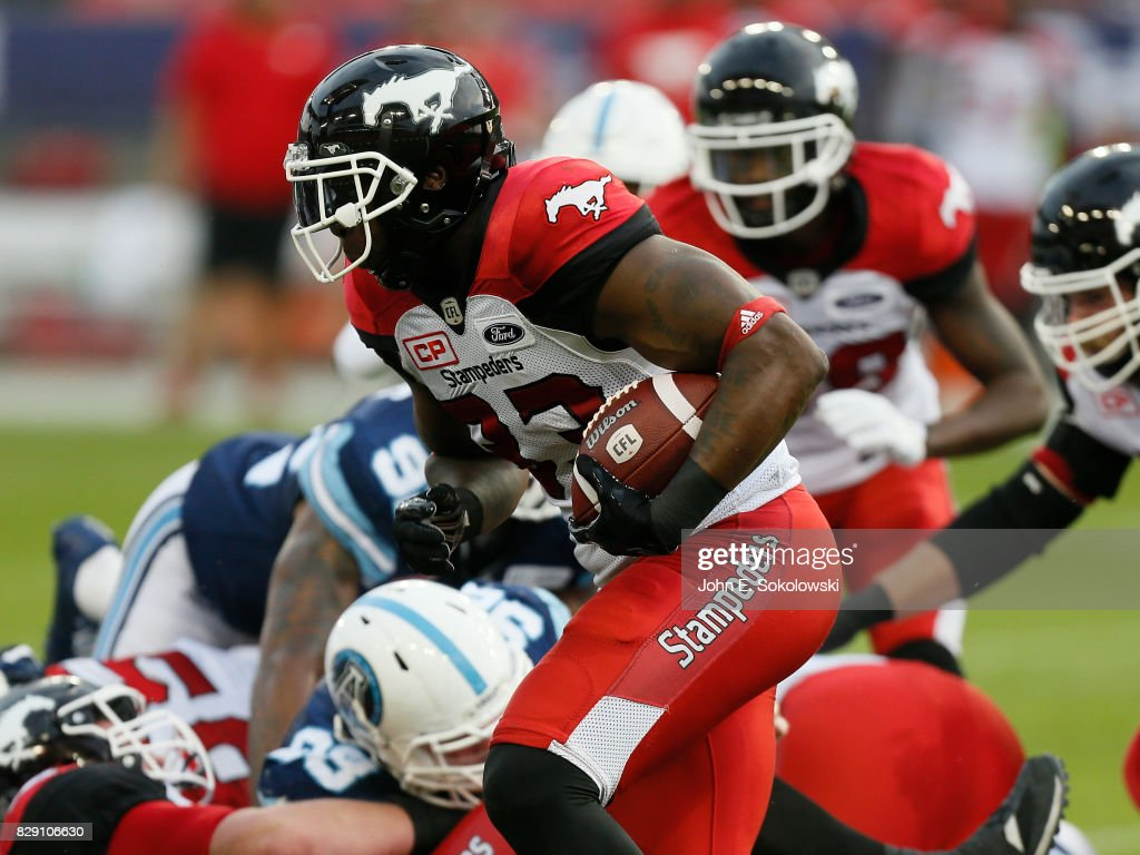 Jerome Messam #33 of the Calgary Stampeders carries the ball against the Toronto Argonauts during a CFL game at BMO Field on August 3, 2017 in Toronto, Ontario, Canada. Calgary defeated Toronto 41-24.