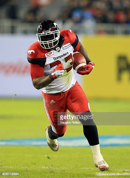 Jerome Messam of the Calgary Stampeders runs with the ball during the second half of the 104th Grey Cup Championship Game against the Ottawa...