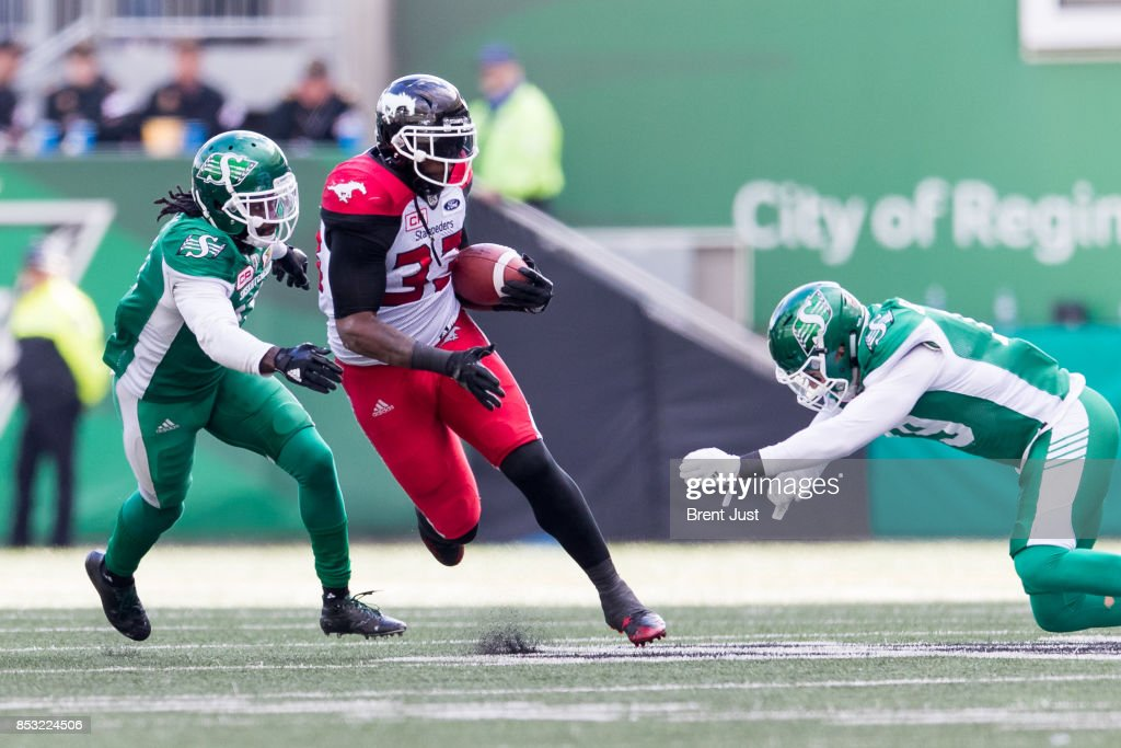 Jerome Messam #33 of the Calgary Stampeders rushes with the ball in the game between the Calgary Stampeders and Saskatchewan Roughriders at Mosaic Stadium on September 24, 2017 in Regina, Canada.