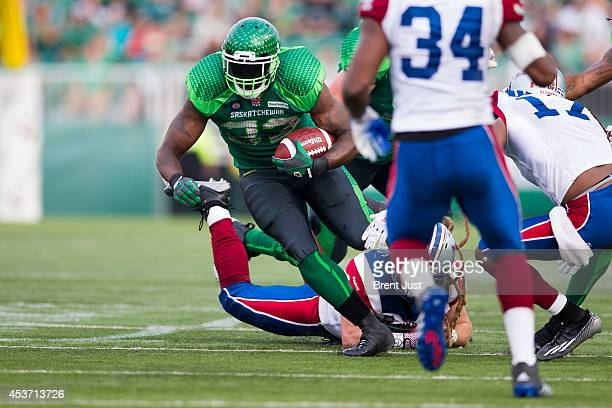 Jerome Messam of the Saskatchewan Roughriders carries the ball in a game between the Montreal Alouettes and Saskatchewan Roughriders in week 8 of the...