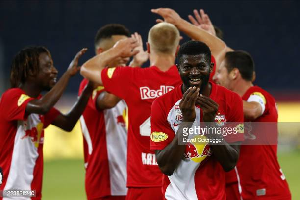 Jerome Onguene of Salzburg celebrates with his teammates after scoring during the tipico Bundesliga match between Red Bull Salzburg and SK Sturm Graz...