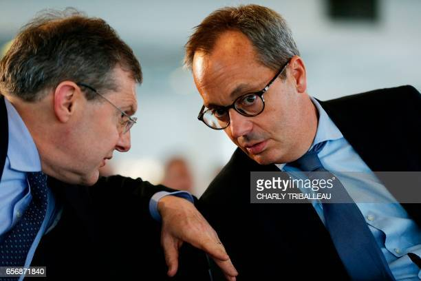Jerome Pecresse, General Electric Renewable Energy's CEO for France, talks with senator Philippe Bas during a ceremony to set up the first foundation...