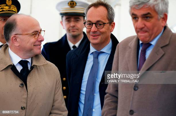 Jerome Pecresse, General Electric Renewable Energy's CEO for France stands next to French Prime Minister Bernard Cazeneuve and former minister Herve...