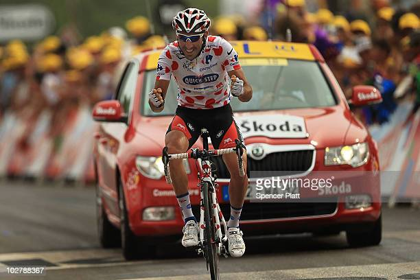 Jerome Pineau crosses the finish line holding onto the polka dot jersey for the King of the Mountains competition of stage seven of the Tour de...