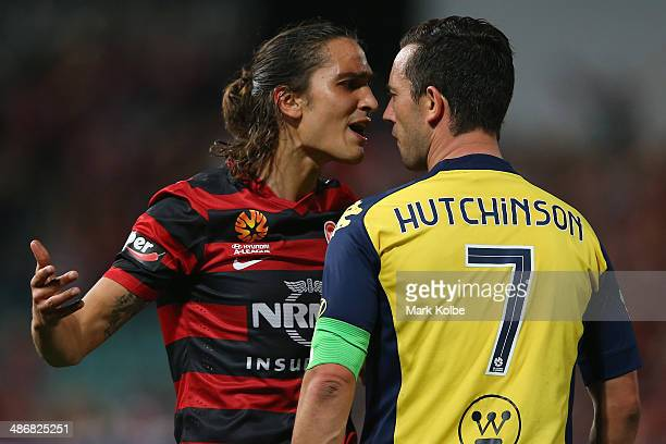 Jerome Polenz of the Wanderers and John Hutchinson of the Mariners exchange heated words during the ALeague Semi Final match between the Western...