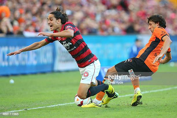 Jerome Polenz of the Wanderers and Thomas Broich of the Roar compete for the ball during the 2014 ALeague Grand Final match between the Brisbane Roar...