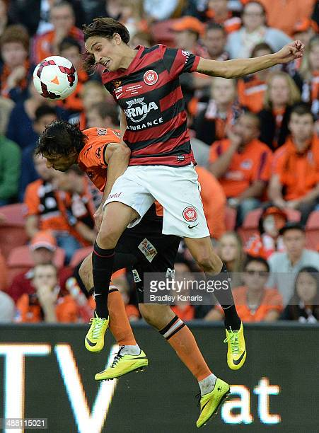Jerome Polenz of the Wanderers and Thomas Broich of the Roar challenge for the ball during the 2014 ALeague Grand Final match between the Brisbane...