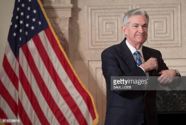 Jerome Powell arrives to takes the oath of office as he is swornin as the new Chairman of the Federal Reserve at the Federal Reserve Building in...