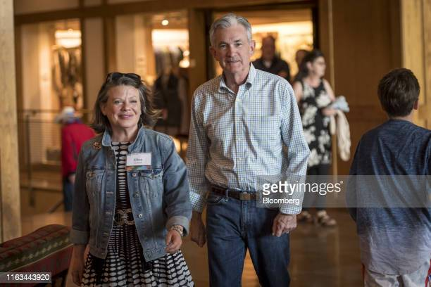 Jerome Powell chairman of the US Federal Reserve and Elissa Leonard arrive for a dinner during the Jackson Hole economic symposium sponsored by the...
