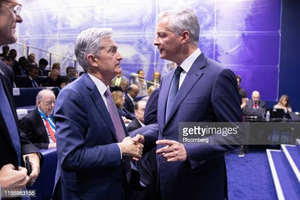 Jerome Powell chairman of the US Federal Reserve left shakes hands with Bruno Le Maire France's finance minister during the 75th anniversary of the...