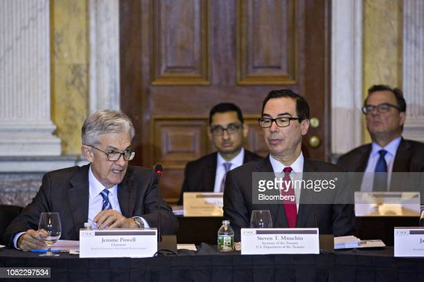 Jerome Powell chairman of the US Federal Reserve left speaks as Steven Mnuchin US Treasury secretary listens during a Financial Stability Oversight...