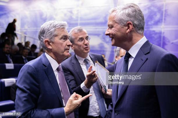 Jerome Powell chairman of the US Federal Reserve left speaks with Bruno Le Maire France's finance minister right and Francois Villeroy de Galhau...