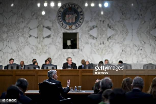 Jerome Powell chairman of the US Federal Reserve nominee for US President Donald Trump center left speaks during a Senate Banking Committee...