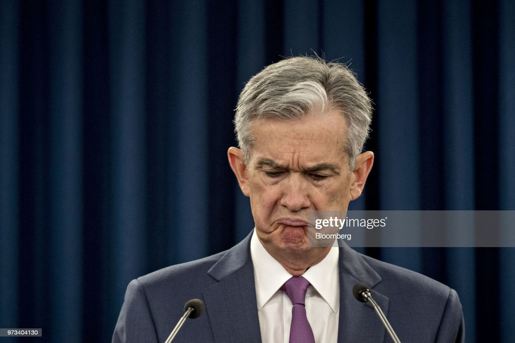 Jerome Powell, chairman of the U.S. Federal Reserve, reacts to a question during a news conference following a Federal Open Market Committee (FOMC) meeting in Washington, D.C., U.S., on Wednesday, June 13, 2018. Federal Reserve officials raised interest rates for the second time this year and upgraded their forecast to four total increases in 2018, as unemployment falls and inflation overshoots their target faster than previously projected. Photographer: Andrew Harrer/Bloomberg via Getty Images