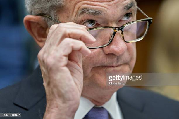 Jerome Powell chairman of the US Federal Reserve removes his glasses during a House Financial Services Committee hearing in Washington DC US on...