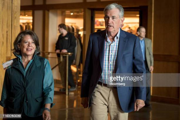 Jerome Powell chairman of the US Federal Reserve right and Elissa Leonard arrive for dinner during the Jackson Hole economic symposium sponsored by...