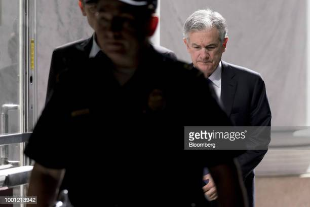 Jerome Powell chairman of the US Federal Reserve right arrives to the Rayburn House Office building before a House Financial Services Committee...