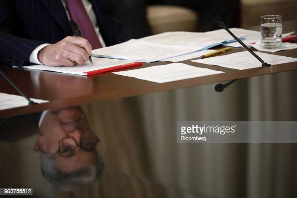 Jerome Powell chairman of the US Federal Reserve writes in a notebook during a meeting with the Board of Governors for the Federal Reserve in...
