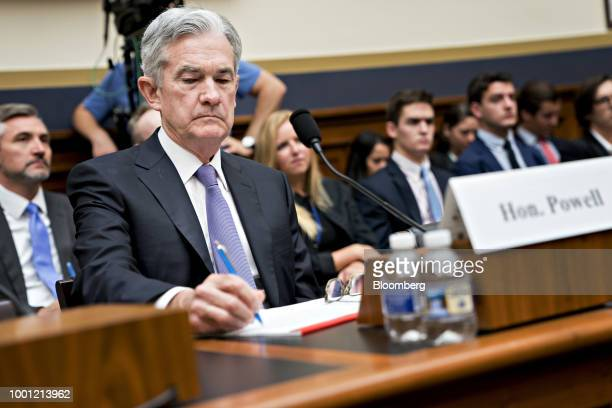 Jerome Powell chairman of the US Federal Reserve writes notes during a House Financial Services Committee hearing in Washington DC US on Wednesday...