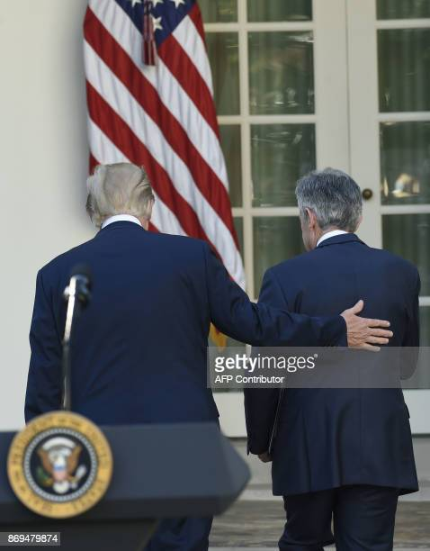 Jerome Powell leaves with US President Donald Trump leave after he was nominated for Chairman of the Federal Reserve in the Rose Garden of the White...