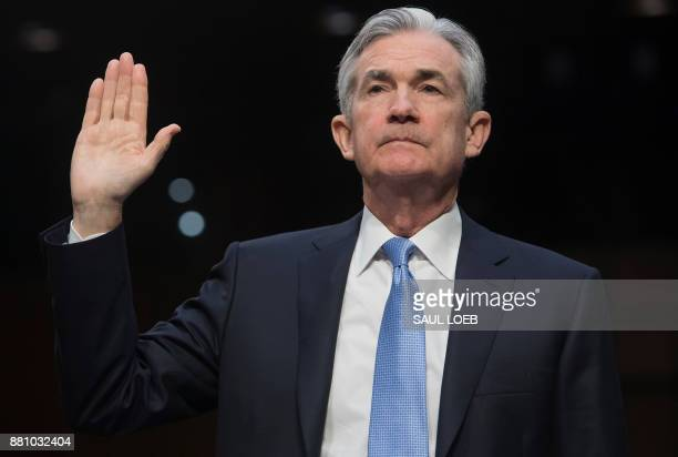 Jerome Powell nominee to be chairman of the Federal Reserve Board of Governors is swornin before testifying during his confirmation hearing before...