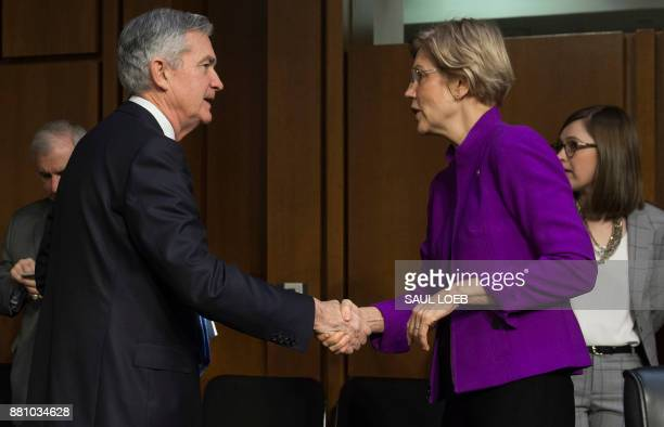 Jerome Powell nominee to be chairman of the Federal Reserve Board of Governors shakes hands with US Senator Elizabeth Warren Democrat of...