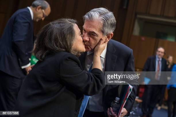 Jerome Powell nominee to be chairman of the Federal Reserve greets his wife Elissa Leonard before his Senate Banking Housing and Urban Affairs...