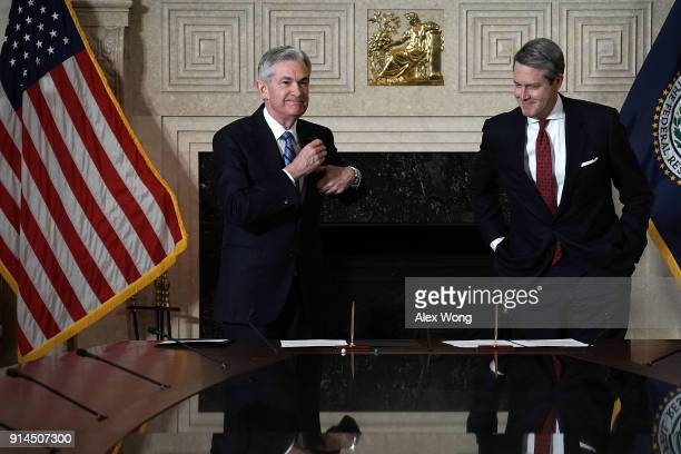 Jerome Powell put his glasses back in his pocket after he signed documents during a swearingin ceremony officiated by Vice Chair for Supervision...